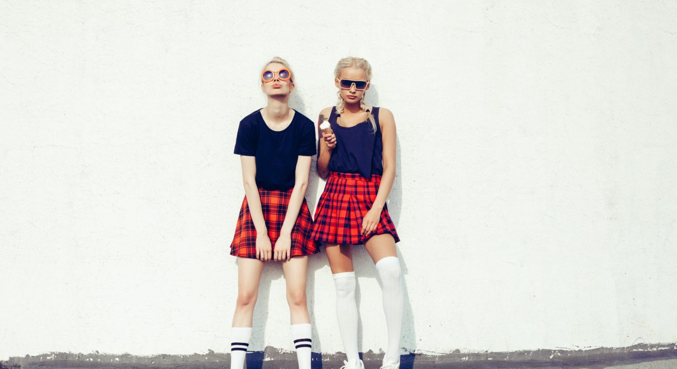 Entity reports on how plaid skirts are bringing back '90s trends.