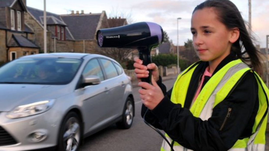 Entity reports on small town Hopeland, Scotland, who is using hairdryers to stop speeding.
