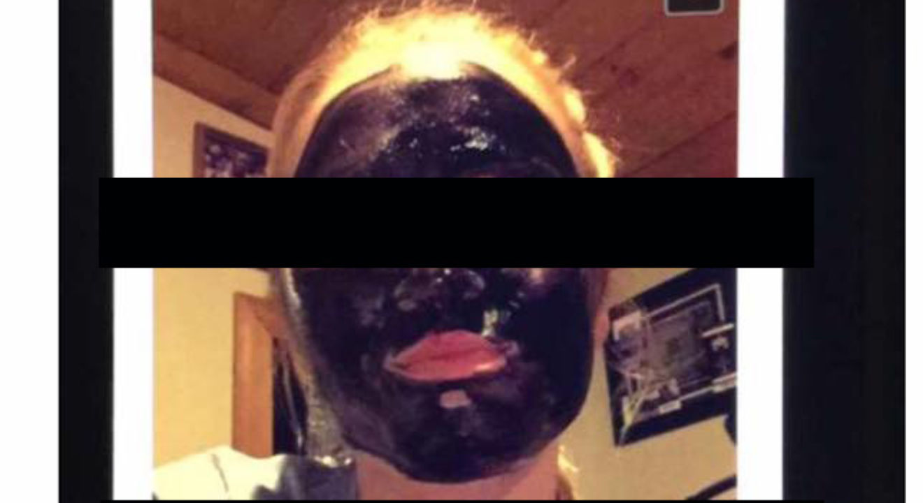 Entity reports on a Spring Arbor University student's racist Snapchat post, in which she appears to be wearing a charcoal mask.