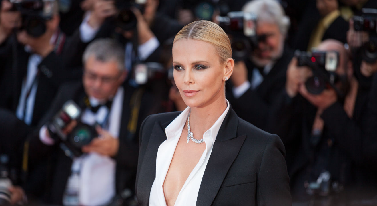 Charlize Theron is getting some serious praise for her new badass, bisexual role.